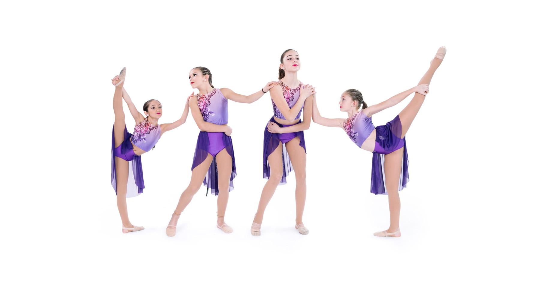 Dancers in purple attire posed